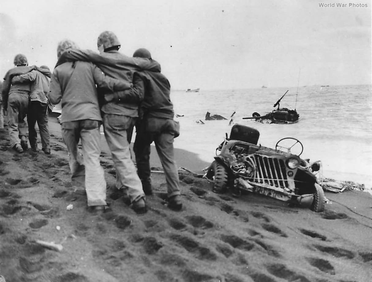 Wounded Marines helped to Aid Station on Iwo Jima