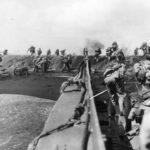 4th Marines pour ashore from LCVP at Iwo Jima