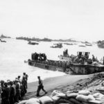 LVT DUKWs and LCVPs at Iwo Jima Beach