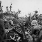 Marine flame thrower team in action on Iwo Jima 21feb