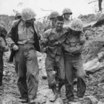 Marines help wounded Japanese Prisoner on Iwo Jima