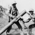 Marines with massive 155mm Japanese Mortar on Iwo Jima