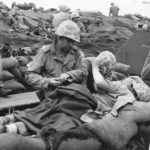 Wounded Marines being treated at Aid Station on Iwo Jima 2