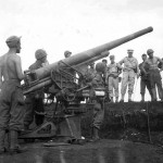 Gen. Eichelberger Examines Captured Japanese Gun in Hollandia