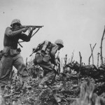 1945 Okinawa1st Div. Marine firing tommy gun