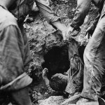 6th Division Marines Pull Wounded Japanese from Cave on Okinawa