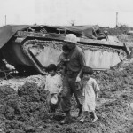 77th Infantry Division Soldier Saving Okinawan Children Next to LVT Buffalo 1945