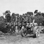 Troops on Captured Japanese 150 mm gun Type 89 Cannon on Okinawa