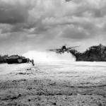 1st US Plane (TBF Avenger) takes off Aslito Airfield Saipan