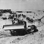 7th AAF Engineers trucks dozer on Saipan Beach