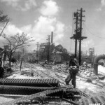 GI's at wreckage of Japanese sugar mill Saipan