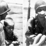 GI's help carry Japanese kids to safety July 4, 1944 Saipan