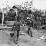 Japanese Work Detail Hauling Water at POW Stockade on Saipan