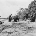 Marines Hit by Japanese Sniper on Saipans Red Beach 1944