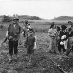 Marines Lead Japanese Women and Children to Safety on Saipan