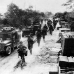 Marines and Jeeps Advance to Front Lines on Saipan