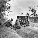 Marines firing 37mm M3 anti tank gun Saipan