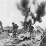 Marines seach for snipers, over Garapan Wreckage Saipan