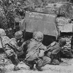 Marines take cover behind a M4A2 named King Kong Saipan 1944