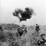 Soldier Blasts Japanese pillbox with Flamethrower on Saipan