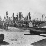 Marines at Memorial Service for Fallen Comrades and F6F Hellcat Tarawa 1943