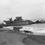 Destroyer and LVT Amtrac Wrecks Landing Craft On Tinian Beach