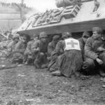 GIs German POW take cover by M10 28feb45