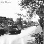 M10 heading to Clark Field passes Shell Oil Sign on Luzon 1945