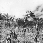 M2A2 tanks of the 192nd Tank Battalion roll through smoke screen during exercises in Arkansas 1941