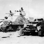 British M3 Grant tank of the 1st Armoured Division and burning Panzer I North Africa