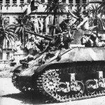 French Soldiers Wave From M3 Stuart tank Moving Thru Streets Toulon 1944