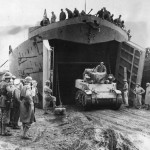 French Troops Watch M5 Stuart Tank Back Into LST-394 In North Africa 1943