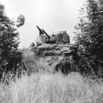 M5 Stuart tank hedgerow busting in Normandy 1944