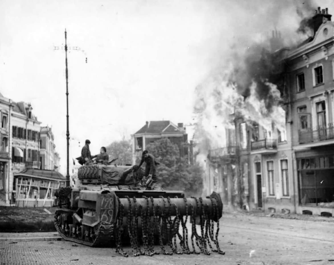 M4 Sherman Flail Tank Moves Up Through The Blazing Town Arnhem 1945