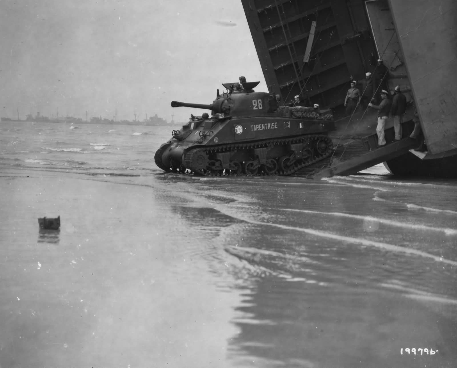 """2nd Free French Armored Division M4A2 Sherman named """"Tarentaise"""" debarks from LST at Utah Beach – 2 August 1944"""