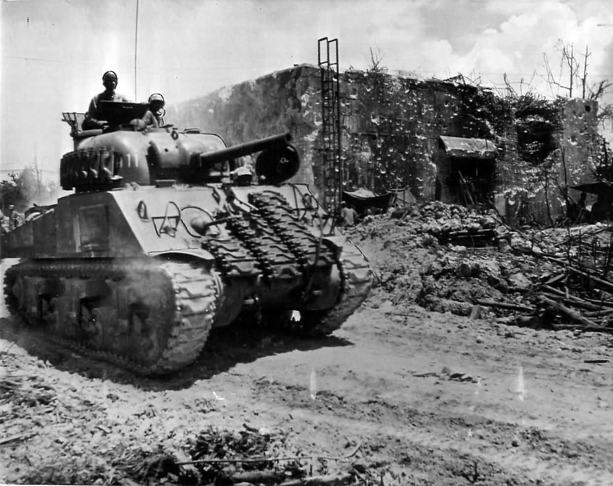 Sherman of company a 1st tank battalion advancing on peleliu 1944
