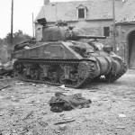 Body of Civilian by US M4 Sherman Tank in Canisy France 1944