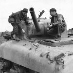 Crew Inspect Bomb Damage to M4A1 Sherman Tank in Nettuno 1944