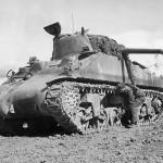 Crewman Adjusts Boggie Wheel on M4 Sherman Tank in Tunisia 1943