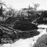M4 Shermans and US Army 40th Inf GIs in mud at Negros Philippines 1945