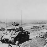Marine M4A2 Sherman tank #62 of the 3rd Tank Battalion advance off beach Iwo Jima