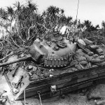 """Marine M4A3 Sherman with wooden side armor, named """"Tokyo Express"""" of the 5th Tank Battalion in ditch Iwo Jima"""