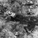 Marine M4 Sherman tank of the 2nd Tank Battalion gets ammo Tinian 1944