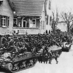 US 7th Army Troops and M4 Sherman Tanks Move thru Captured German Town