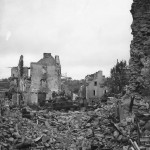 US Troops and M4 Sherman Tank Moving thru Ruins of Coutances 1944