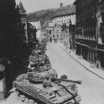 Long row of M4A3(76)W Sherman HVSS tanks enter Eichstatt Germany, 25 April 1945. Shermans of the 25th Tank Battalion, 14th Armored Division
