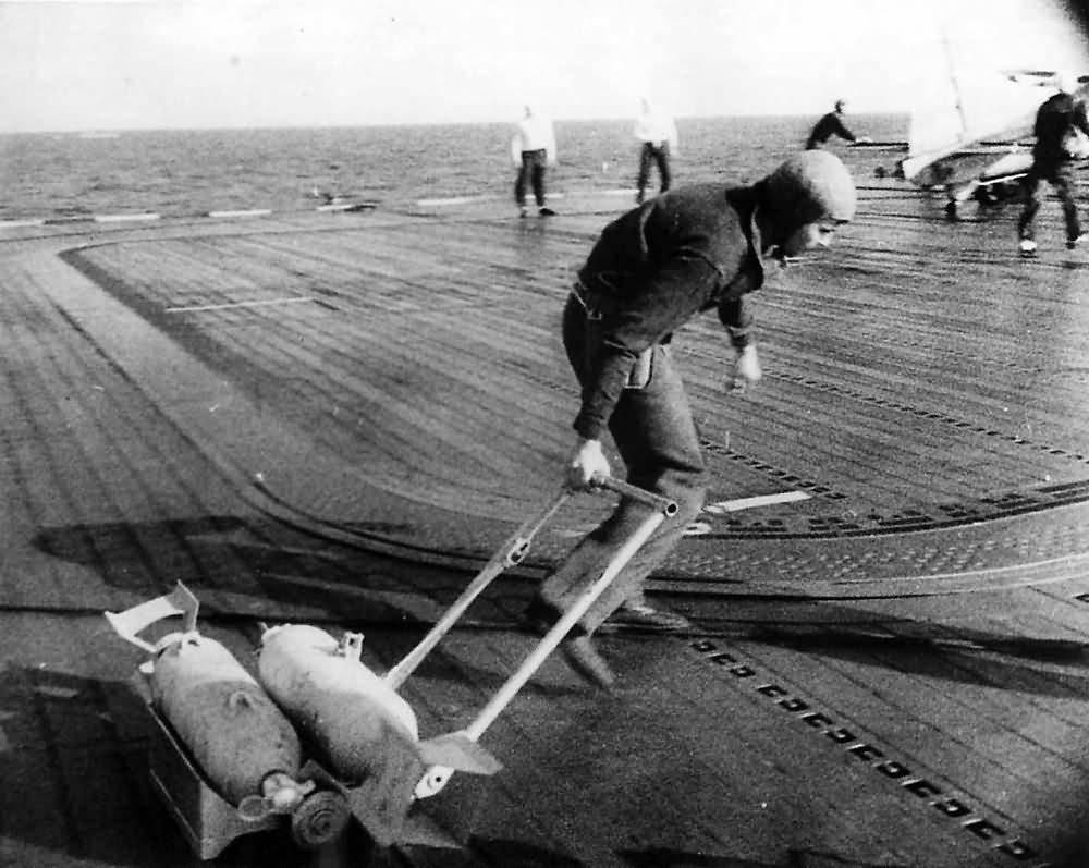 Sailor Hauls Bombs for US Navy Raid on Marshall and Gilbert Islands 1942