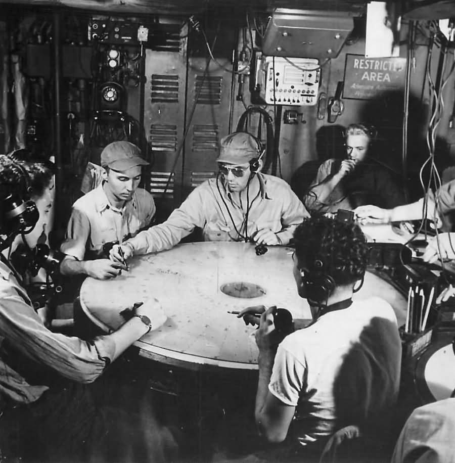 Troops plotting in radar room aboard an Essex class aircraft carrier 1944