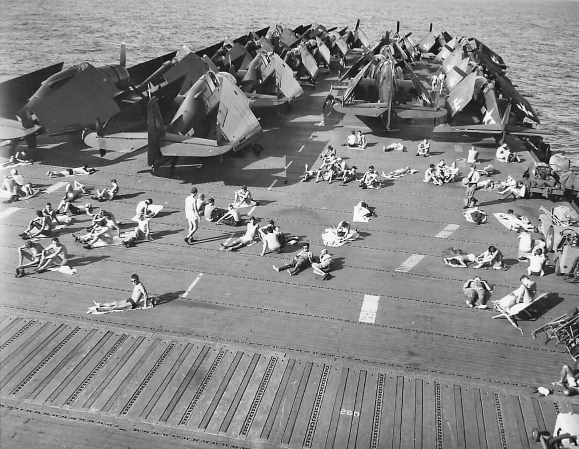 sailors sunbathing on flight deck of uss uss enterprise cv