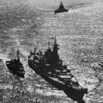 Escorted by the NICHOLAS DD 449 and followed by USS IOWA BB 61 USS MISSOURI BB 63 steams up Tokyo Bay on August 30th 1945